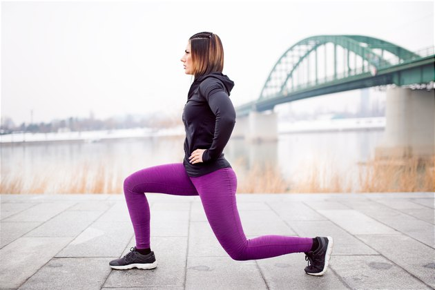 Fitness woman split squat exercise outdoor