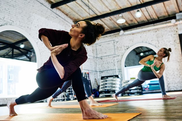 Women in a yoga class at an industrial gym