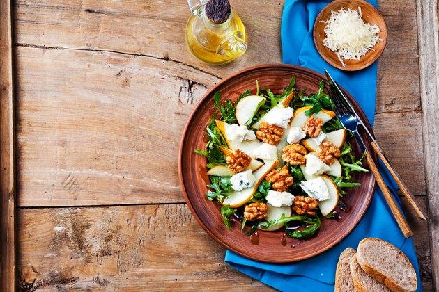 salad bowl with gorgonzola, arugula, walnuts and pear
