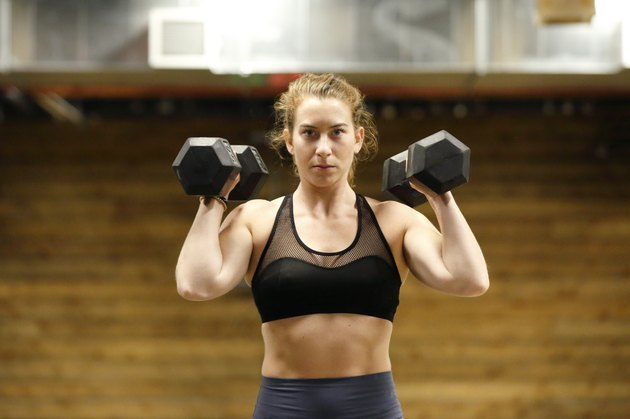 Fit, young woman doing a full-body dumbbell workout for beginners