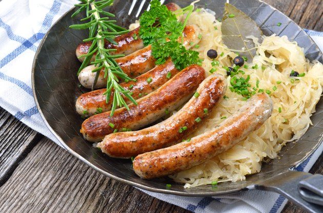 Sausages are served together with sauerkraut on a metal pan