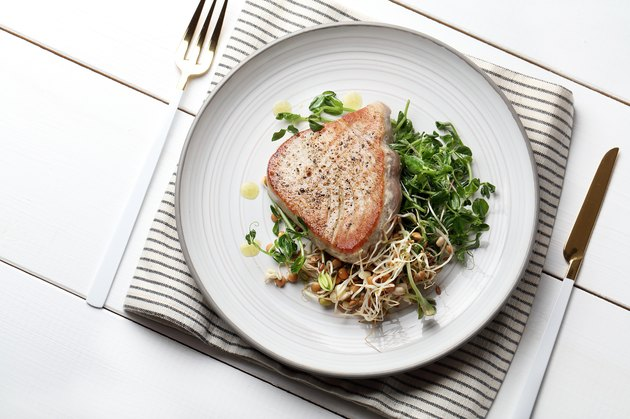 Grilled tuna with young pea sprouts, lentils and beans