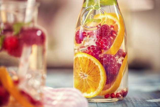 Infused water with natural sweeteners like fresh raspberries, lemon,  pomegranate and mint