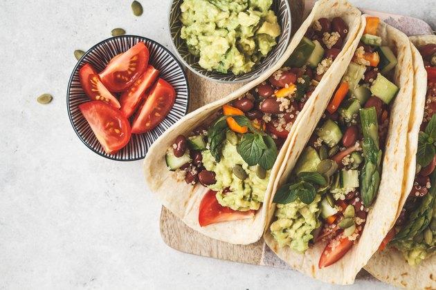 Vegan tortillas with quinoa, asparagus, beans, vegetables and guacamole.