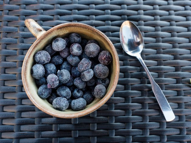Close-Up of Blueberries in Cup on Wicker Mat