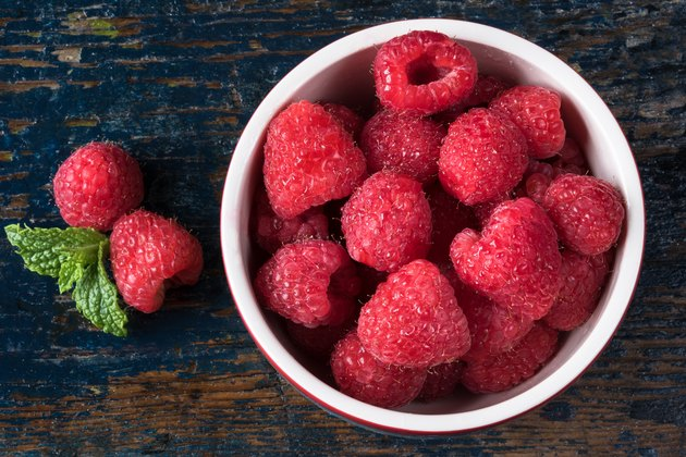 High Angle View Of Raspberries In Bowl On Table