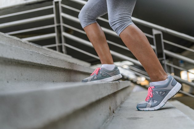 Legs and Shoes of a Jogger Running up a Staircase