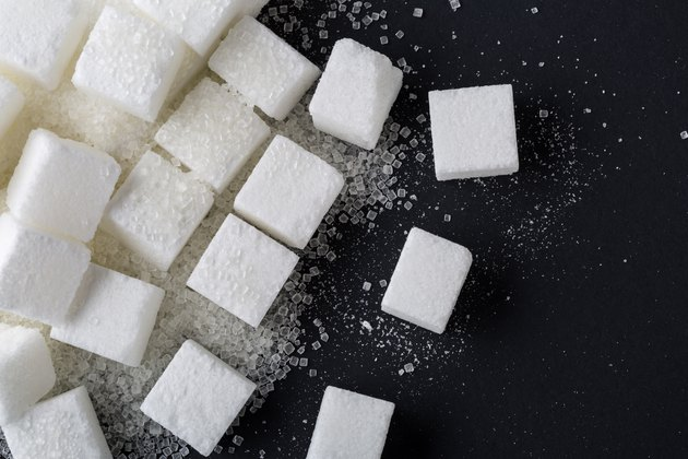 Background of sugar cubes. Top view