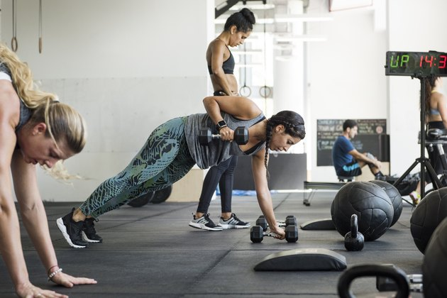 Female athletes doing crossfit training in crossfit gym