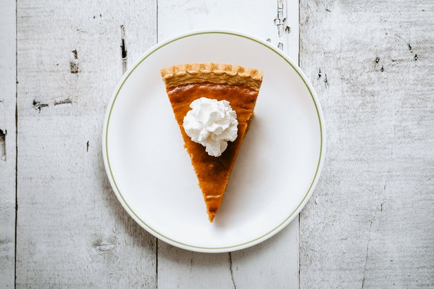 Pumpkin Pie Slice on Rustic Background