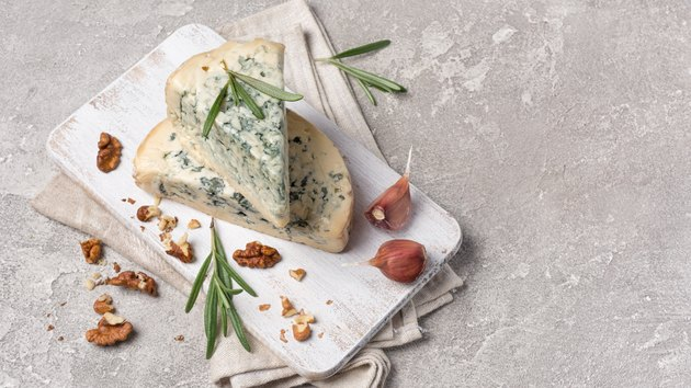 Tasty soft blue cheese with spices of rosemary and garlic