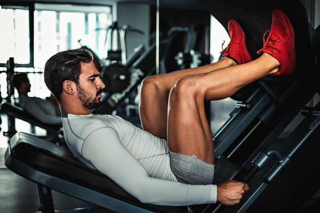 Man focused on training legs on the machine