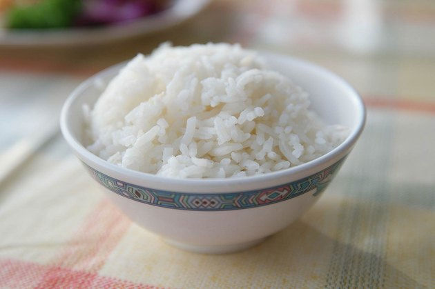 Steamed Rice Served In Bowl On Table