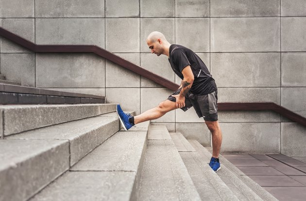 Man Stretching With Achilles Tendon Pain