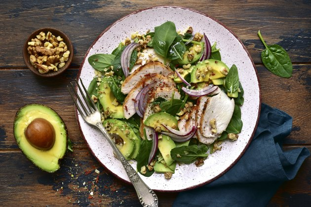 Spinach salad with grilled chicken fillet, avocado and walnuts