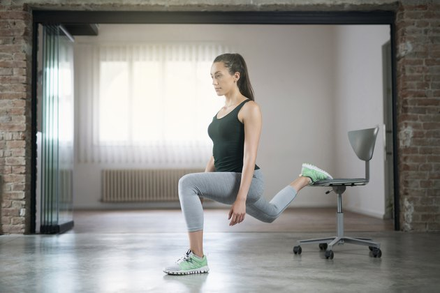 woman doing Single-Leg Elevated Split Squat with desk chair