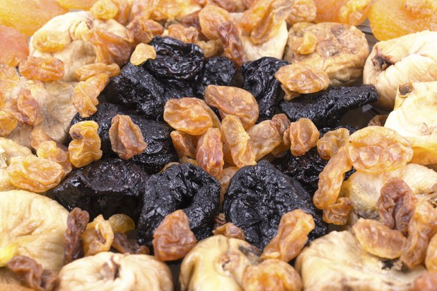 Dried fruits close up picture. Raisins, prunes, dried apricots, dried figs