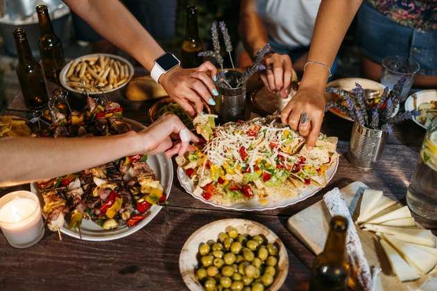 Close-up of friends eating during an outdoor dinner