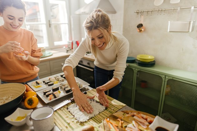 Friends making sushi at home