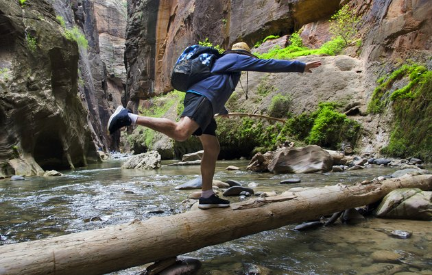 Man Hiking in The Narrows of Zion National Park