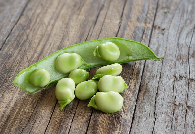 broad beans on wooden table