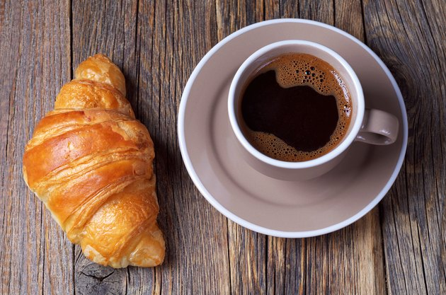 Croissant with coffee cup
