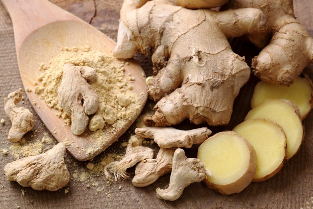 Ginger root and ginger powder on a table as a spice for weight loss