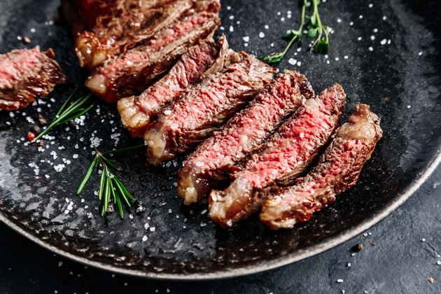 New York Striploin steak medium rare with rosemary top view