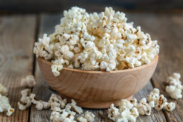 Wooden bowl filled with air-popped popcorn