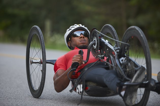 African American man riding a handcycle