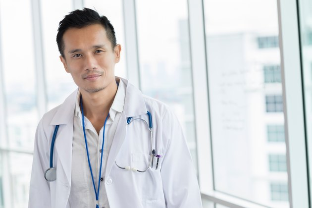 Medical doctor in lab coat looking serious