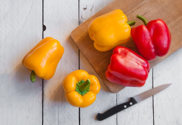 Fresh bell peppers on cutting board