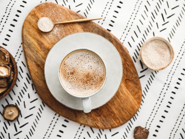 Top view of a chaga mushroom latte set on a patterned tablecloth