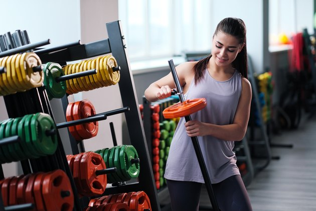 Beautiful sporty young brunette woman in sportswear in the gym.