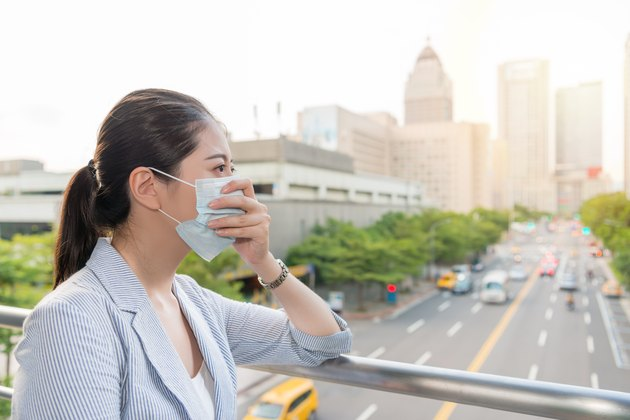 businesswoman feels allergy from bad air