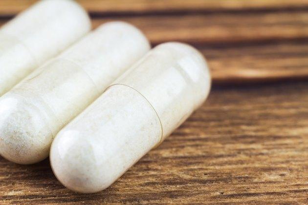 Food supplement pills, glucosamine capsules, macro image