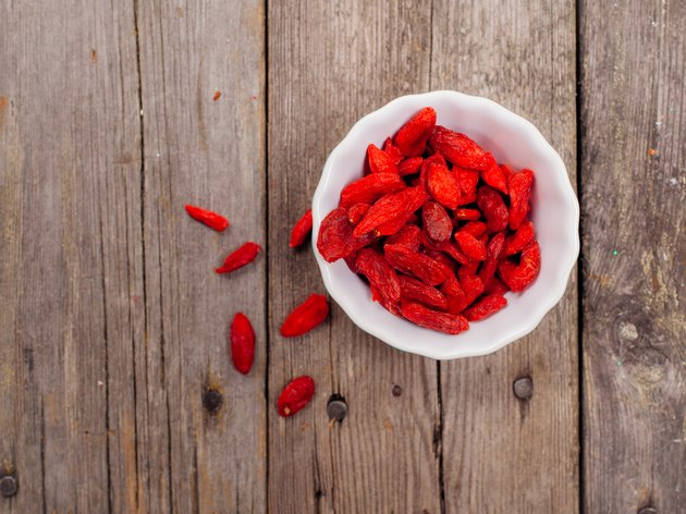 Gojiberries in a bowl on wooden background