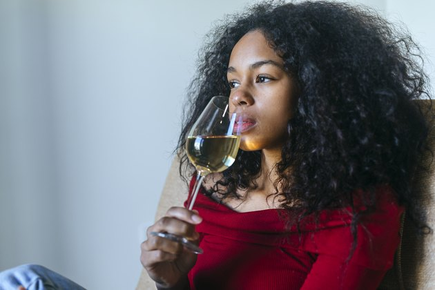 woman drinking glass of white wine