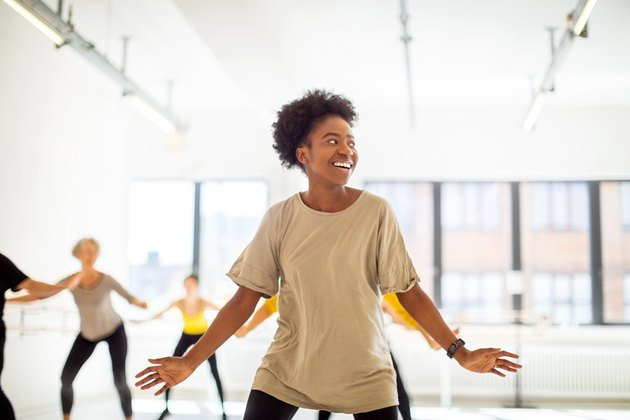 Woman practicing fitness dance moves