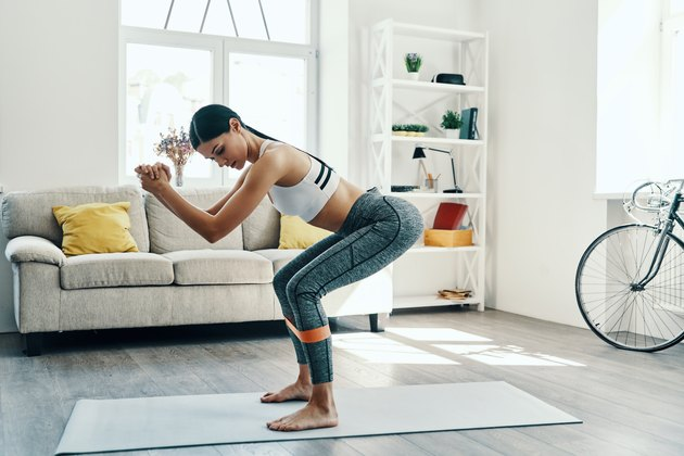 Woman doing a butt and ab workout at home