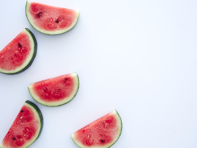 Sweet watermelon slices on white background
