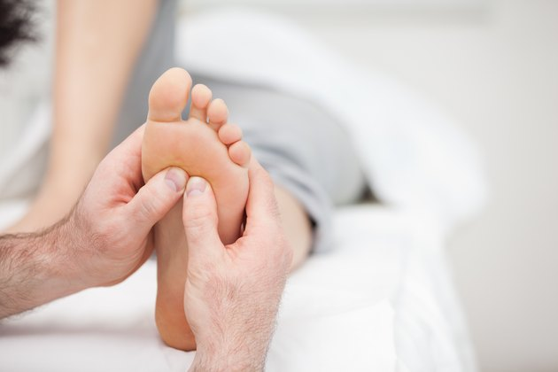 Foot being massaged on a medical table