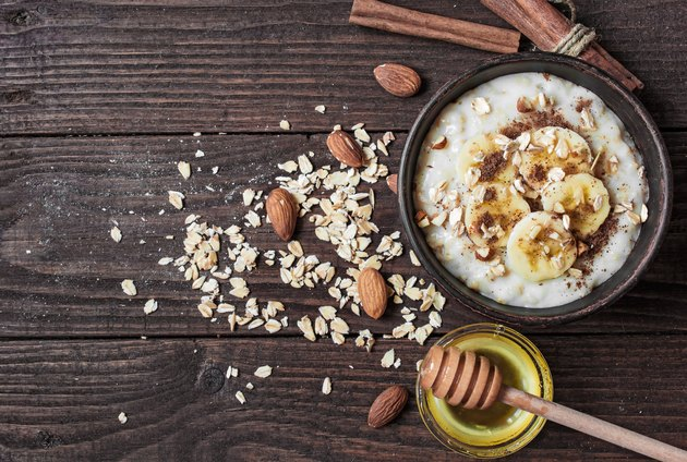 healthy homemade oatmeal porridge with nuts, banana, cinnamon and honey