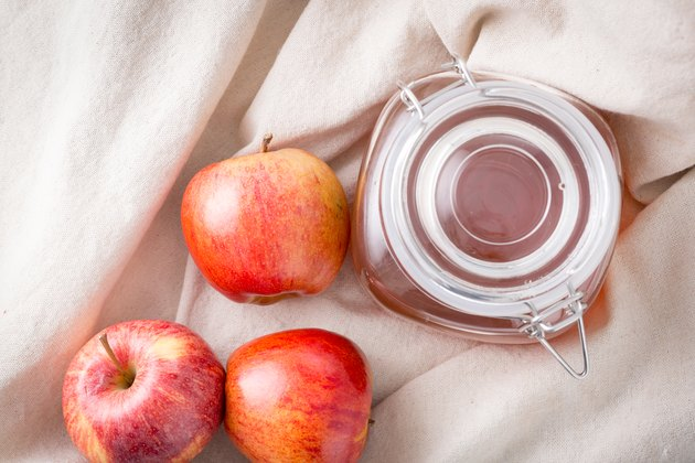 Top view of apple juice with fresh apples