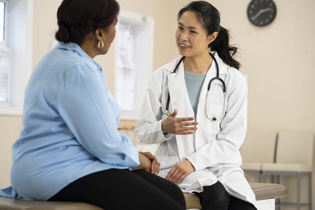 A doctor talking to a senior woman with prediabetes