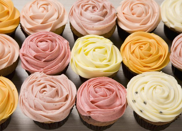 Various coloured rose cupcakes