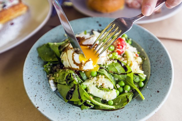 acetylcholine close up of healthy salad with quinoa, green peas, spinach and poached egg