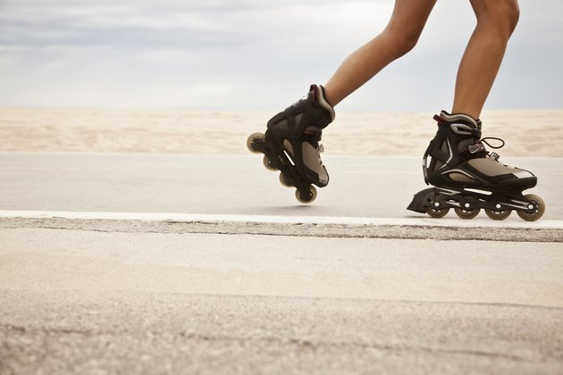 woman's legs rollerblading outside for 20-minute HIIT workout