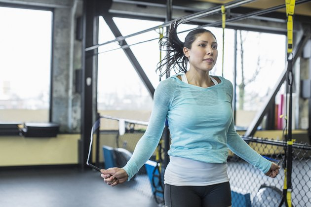 Woman jumping rope at the gym as part of interval cardio workout