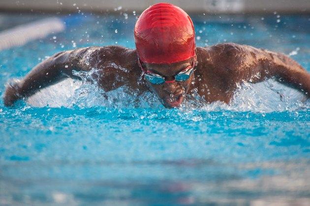 Male swimmer doing butterfly stroke in pool